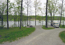 Spaces for RV and tent camping overlook the lake